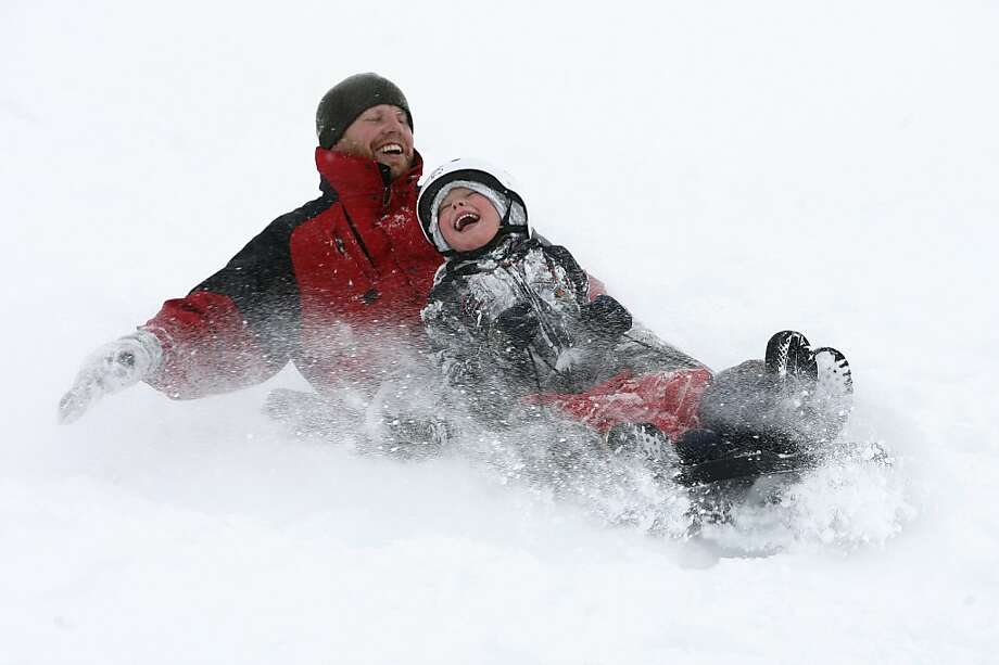 Brent Giles, left, and Dylan Giles enjoy the new snow as they sled on a hill near Mueller Park Jr High, in Bountiful, Utah, Friday, Dec. 28, 2012. Photo: Rick Egan, Associated Press