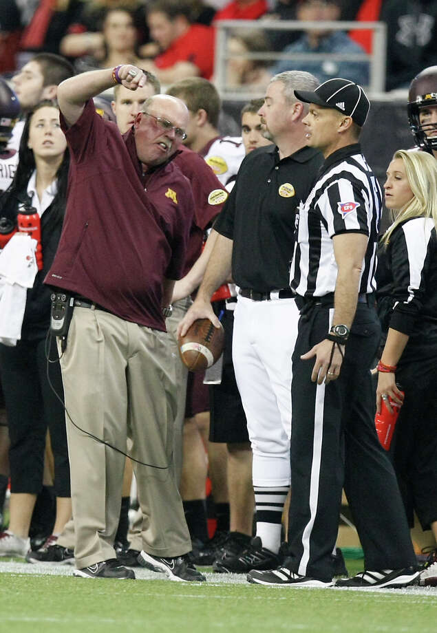 Minnesota head coach Jerry Kill becomes very mad at a referee after his team was called for a collection of violations during the second quarter of his Meineke Car Care Bowl college football game, Friday, Dec. 28, 2012, in Reliant Stadium in Houston. Photo: Nick De La Torre, Houston Chronicle / © 2012  Houston Chronicle
