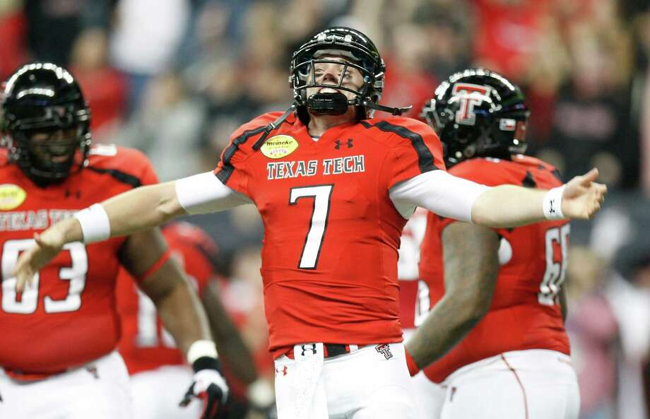 Texas Tech quarterback Seth Doege, celebrates his touchdown dive during the second quarter of his Meineke Car Care Bowl college football game against Minnesota, Friday, Dec. 28, 2012, in Reliant Stadium in Houston. Photo: Nick De La Torre, Houston Chronicle / © 2012  Houston Chronicle