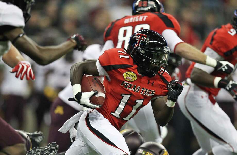 Texas Tech kick returner Jakeem Grant races to the end zone for a touchdown during the first quarter of his Meineke Car Care Bowl college football game against Minnesota, Friday, Dec. 28, 2012, in Reliant Stadium in Houston. Photo: Nick De La Torre, Houston Chronicle / © 2012  Houston Chronicle