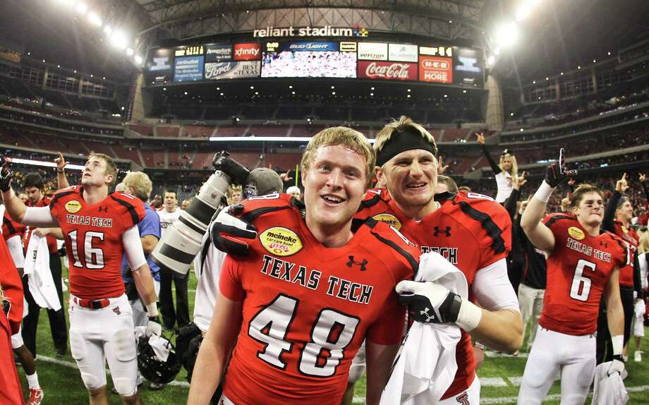 Texas Tech place kicker Ryan Bustin (48) won the Meineke Car Care Bowl college football game with a last second field goal, Saturday, Dec. 29, 2012, in Reliant Stadium in Houston.  Texas Tech won 34-31. Photo: Nick De La Torre, Houston Chronicle / © 2012  Houston Chronicle