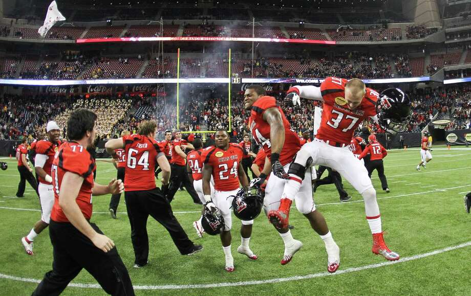 Texas Tech's Kenny Williams (34) and Chris Yeakey celebrate after Texas Tech made the winning field goal to win the Meineke Car Care Bowl college football game, Saturday, Dec. 29, 2012, in Reliant Stadium in Houston.  Texas Tech won 34-31. Photo: Nick De La Torre, Houston Chronicle / © 2012  Houston Chronicle