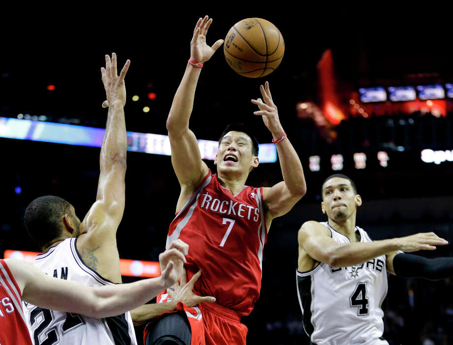Dec. 28: Spurs 122, Rockets 116Jeremy Lin (7) loses control of the ball as Tim Duncan, left, and Danny Green (4) defend his drive to the basket. Photo: Eric Gay, Associated Press / AP