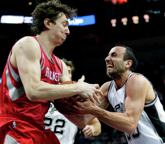 Manu Ginobili, right, of Argentina, loses control of the ball as Omer Asik, left, of Turkey, defends. Photo: Eric Gay, Associated Press / AP
