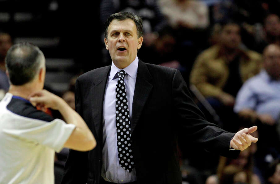 Rockets head coach Kevin McHale, right, argues a call.