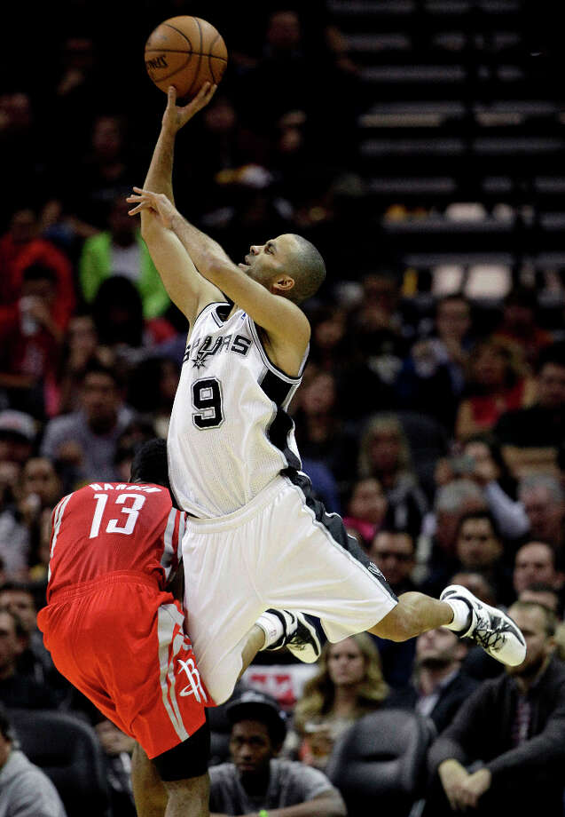Tony Parker (9), of France, crashes into James Harden (13) as he shoots. Photo: Eric Gay, Associated Press / AP