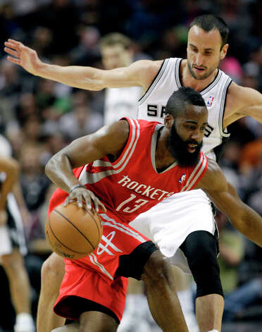 James Harden (13) tries to move the ball around Manu Ginobili, right, of Argentina. Photo: Eric Gay, Associated Press / AP