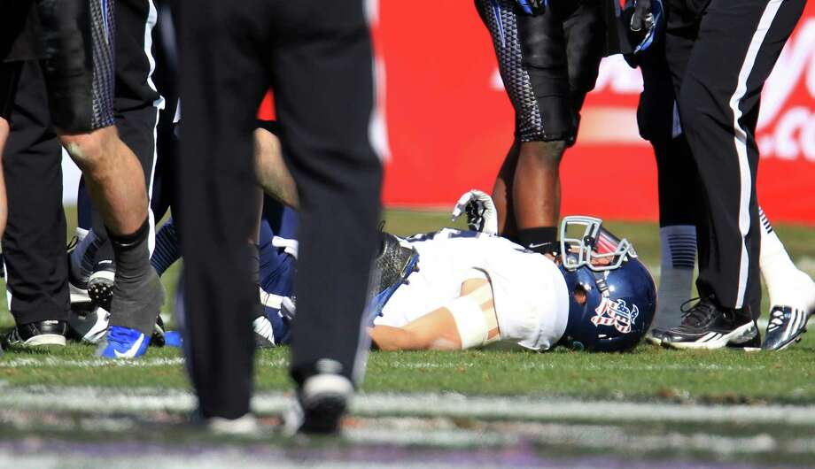Rice quarterback Taylor McHargue (16) lies on the ground with a concussion after getting hurt on the play, and was taken out of the game during the first half of the Bell Helicopter Armed Services Bowl at Amon G. Carter Stadium, Saturday, Dec. 29, 2012, in Ft. Worth. Photo: Karen Warren, Houston Chronicle / © 2012 Houston Chronicle