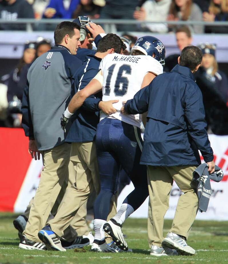 Rice quarterback Taylor McHargue (16) is helped off the field after suffering a concussion during the first half of the Bell Helicopter Armed Services Bowl at Amon G. Carter Stadium, Saturday, Dec. 29, 2012, in Ft. Worth. Photo: Karen Warren, Houston Chronicle / © 2012 Houston Chronicle