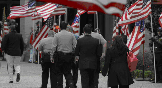 Mourners attend the funeral of a Bellaire police officer. (Melissa Phillip/Chronicle)