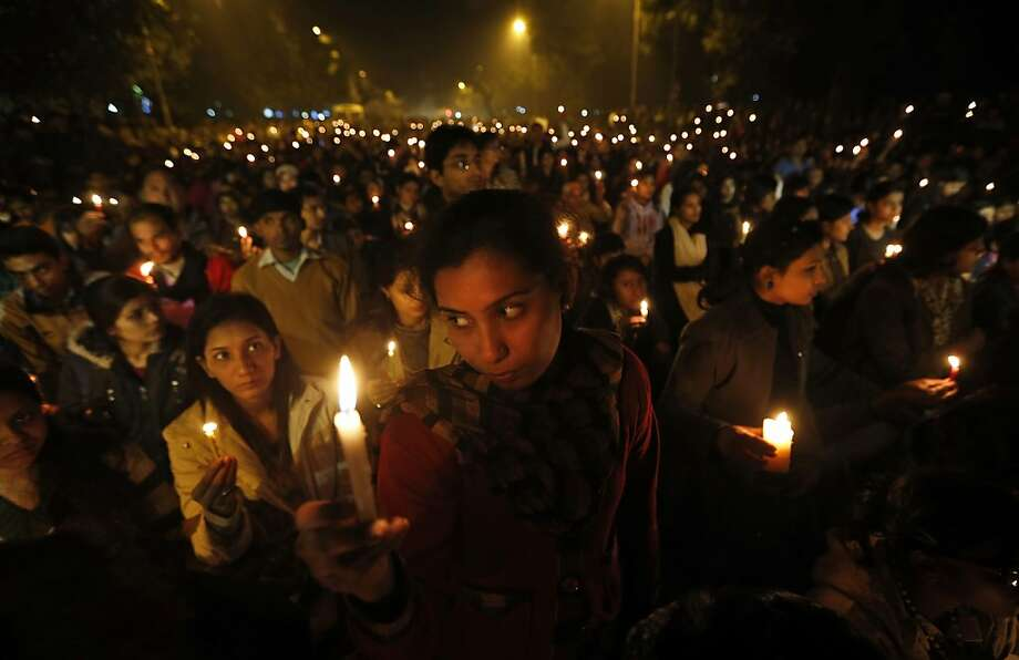 Indians light candles as they mourn the death of a gang rape victim in New Delhi, India , Saturday, Dec. 29, 2012. Indian police charged six men with murder on Saturday, adding to accusations that they beat and gang-raped the woman on a New Delhi bus nearly two weeks ago in a case that shocked the country. The murder charges were laid after the woman died earlier Saturday in a Singapore hospital where she has been flown for treatment.  (AP Photo/ Saurabh Das) Photo: Saurabh Das, Associated Press