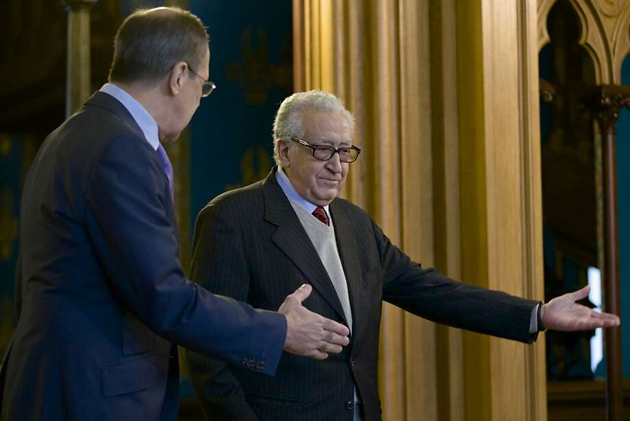 Russian Foreign Minister Sergey Lavrov, left, welcomes U.N. envoy for Syria Lakhdar Brahimi during their meeting in Moscow, Russia, on Saturday, Dec. 29, 2012. (AP Photo/Ivan Sekretarev) Photo: Ivan Sekretarev, Associated Press