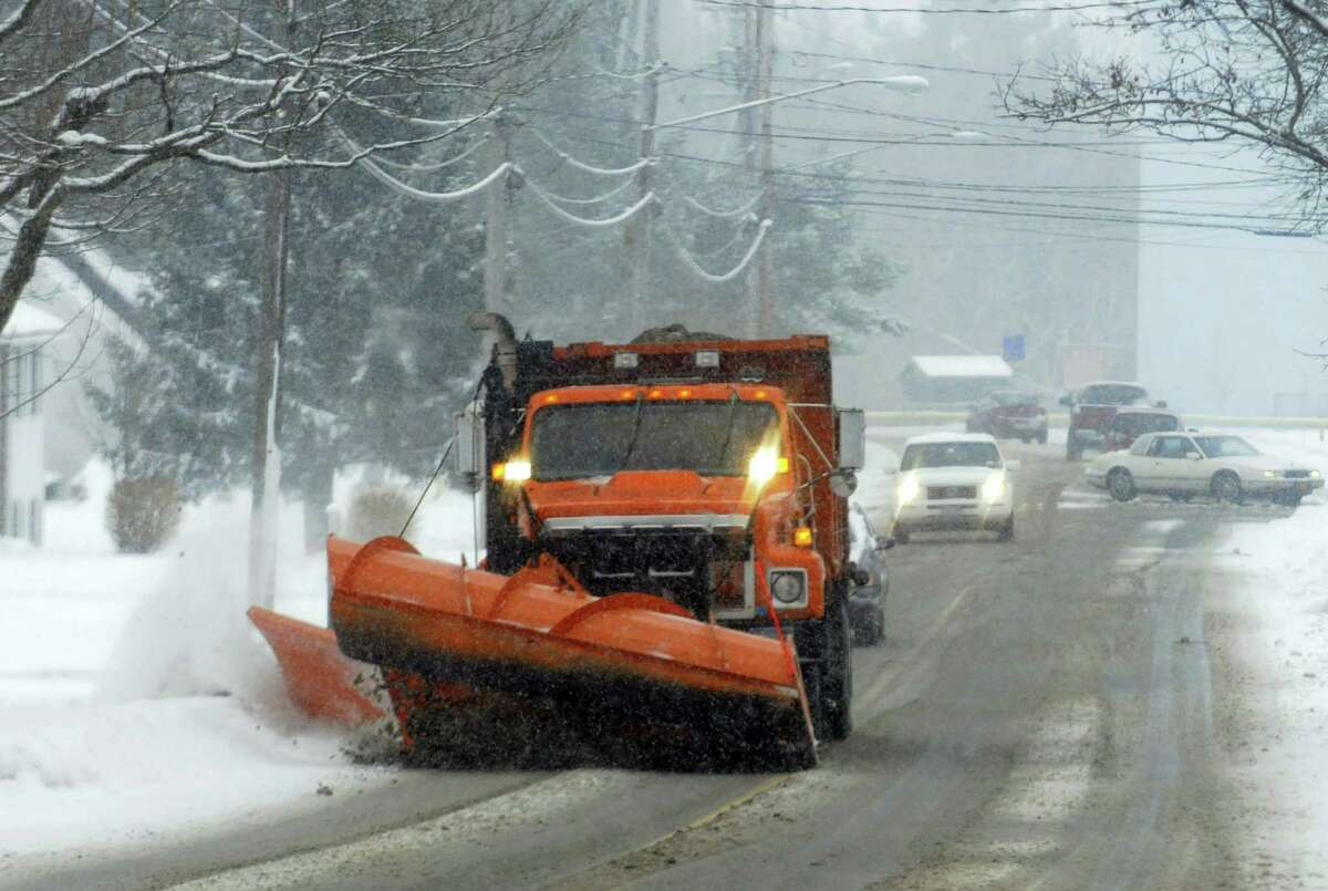 A plow clears Midline Road in Amsterdam on Saturday as snows accumulate across the state. (Michael P. Farrell/Times Union)