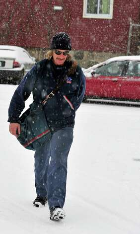 Letter Carrier Bob Steinerd trudges through the snow to deliver the mail in Danbury Saturday, Dec. 29, 2012. Photo: Michael Duffy