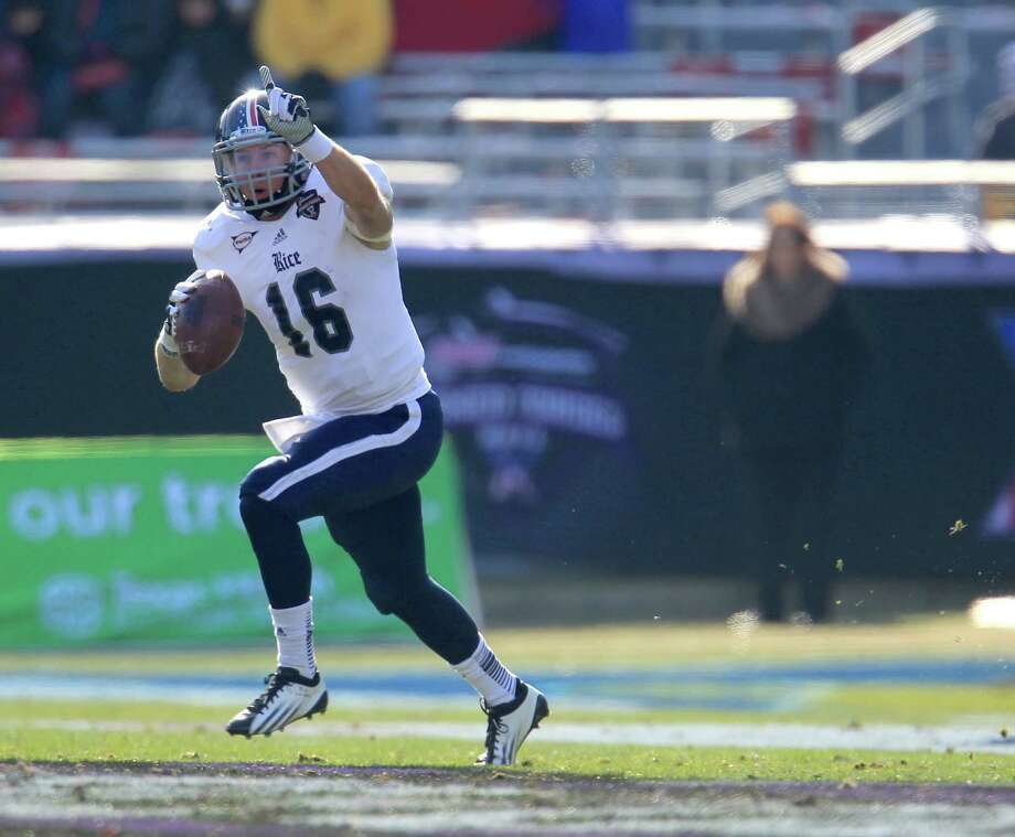 Rice quarterback Taylor McHargue (16) scrambles with the ball during the first half of the Bell Helicopter Armed Services Bowl at Amon G. Carter Stadium, Saturday, Dec. 29, 2012, in Ft. Worth. Photo: Karen Warren, Houston Chronicle / © 2012 Houston Chronicle