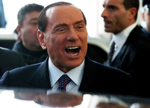 "Former Italian premier Silvio Berlusconi smiles as he arrives at Milan's central train station, Italy, Saturday, Dec. 29, 2012. Italian Premier Mario Monti announced Friday he is heading a new campaign coalition made of up centrists, business leaders and pro-Vatican forces who back his ""ethical"" vision of politics, aiming for a second mandate in office if his fledging reform movement wins big in parliamentary elections. Monti was appointed premier 13 months ago after his scandal-plagued predecessor Silvio Berlusconi failed to stop Italy from sliding deeper into the eurozone debt crisis. He quit earlier this month after Berlusconi pulled his party's support from Monti's government, but is now continuing in a caretaker role until the next elections. (AP Photo/Luca Bruno) Photo: Luca Bruno"