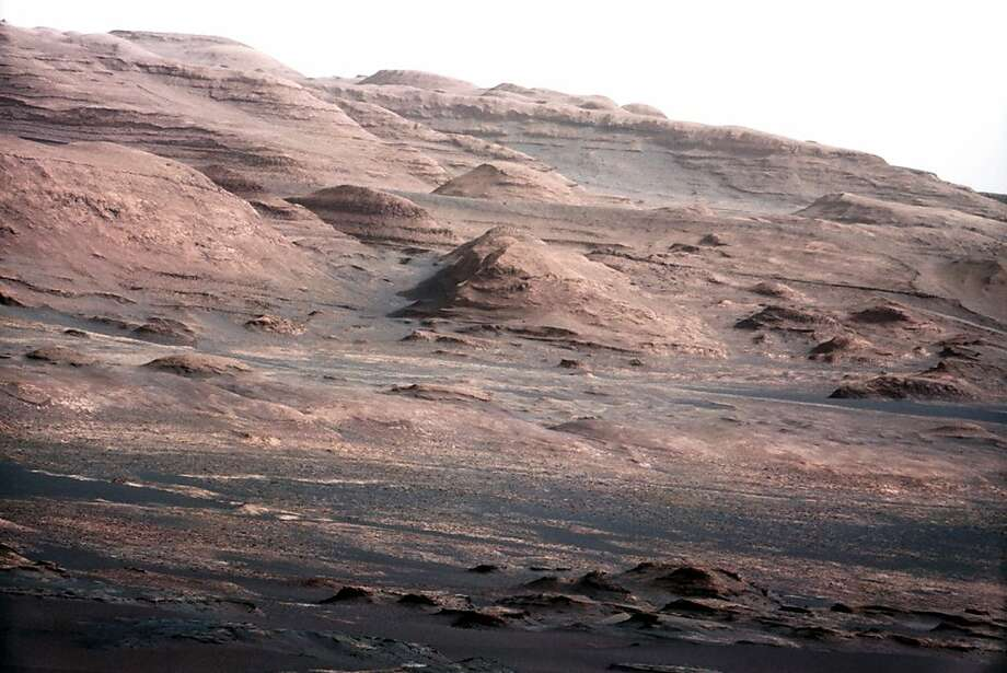 In mid-February, the rover will start a nine-month drive toward Mount Sharp on Mars, shown in August, after it finishes drilling into its first rock. Photo: Anonymous, Associated Press