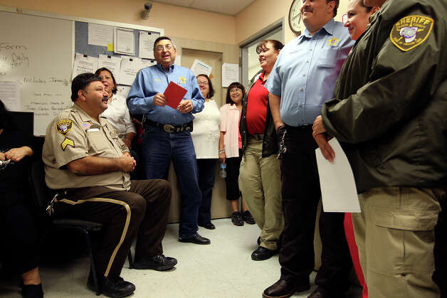 "Holding a red envelope, Zapata County Sheriff Sigifredo Gonzalez, Jr., addresses his staff and ""formally"" announces his retirement during a tamalada, Thursday, Dec. 13, 2012. Gonzalez will retire at the end of the year after nearly 19 years in office. The card was a gift from his staff. Photo: Jerry Lara, San Antonio Express-News / © 2012 San Antonio Express-News"