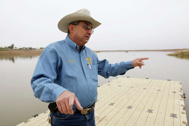 Zapata County Sheriff Sigifredo Gonzalez, Jr. stands on a dock near a boat ramp on Lake Falcon, Thursday, Dec. 13, 2012. Gonzalez will retire at the end of the year after nearly 19 years in office. The dock is the area where American David Hartley and his wife, Tiffany, took off in their jet skies in 2010. They headed to the Mexican side of the lake and encountered drug cartel members who shot them. While she was able to escape, her husband died. The case brought national attention to the area and the sheriff was a daily fixture in television and newspaper reports. Photo: Jerry Lara, San Antonio Express-News / © 2012 San Antonio Express-News