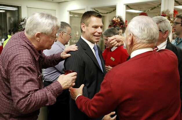 Eric Swalwell appears at a Dublin holiday party. Photo: Carlos Avila Gonzalez, The Chronicle
