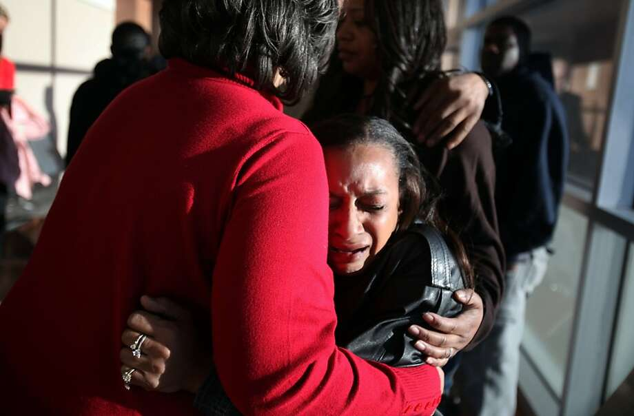 Brenda Morris, center facing, grandmother of 10-year-old Jade Morris' hugs Jade's other grandmother, Claudette Flanagan-Jones, left, outside the courtroom after Brenda Stokes Wilson appeared in Las Vegas Justice Court for a hearing at the Regional Justice Center in Las Vegas, Friday, Dec. 28, 2012. A body has been found that is believed to be that of Jade Morris, who was last seen with Wilson. (AP Photo/The Las Vegas Sun, Leila Navidi) Photo: Leila Navidi, Associated Press
