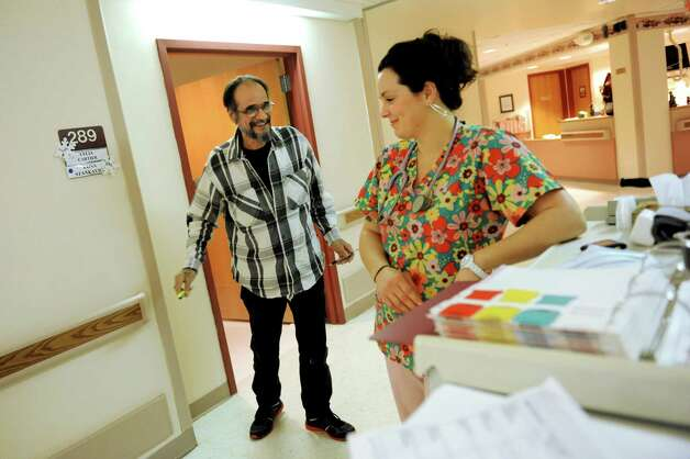 Samuel Baez, also known as Poppy, left, jokes with nurse Melissa Hildreth in the hallway on Friday, Dec. 21, 2012, at Capstone Center for Rehabilitation and Nursing in Amsterdam, N.Y. (Cindy Schultz / Times Union) Photo: Cindy Schultz / 00020537A
