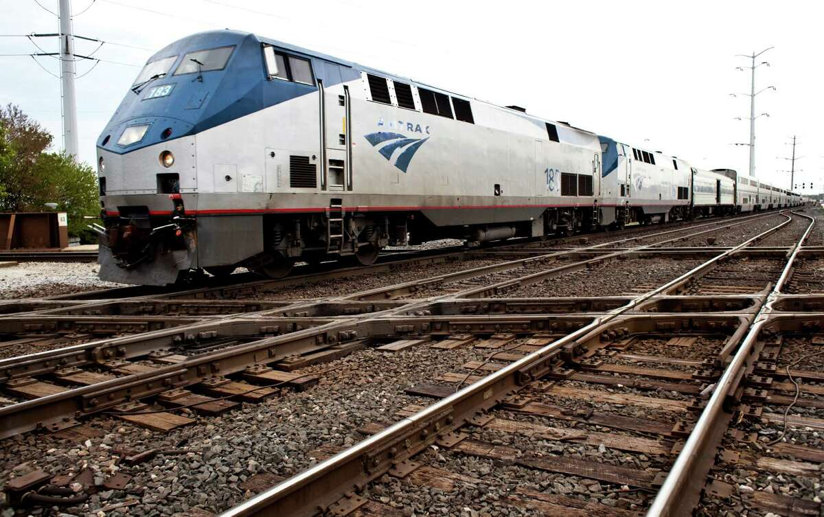 An Amtrak train passes through Chicago's south side, on May 2, 2012. Federal, state, local and industry officials are completing the early stages of a project to untangle Chicago's rail system, which currently delays cross-country freight loads. (Nathan Weber/The New York Times)