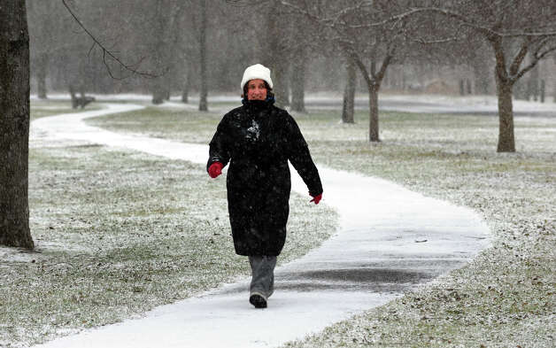 Alicia Kolber, of Trumbull, takes a stroll through Veterans Park in Trumbull, Conn. on Saturday December 29, 2012. Photo: Christian Abraham / Connecticut Post