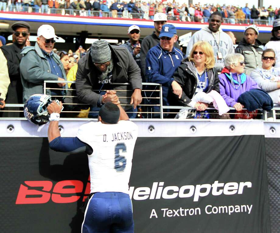 Rice quarterback Driphus Jackson (6) celebrates the Owl's win with fans after the Bell Helicopter Armed Services Bowl at Amon G. Carter Stadium, Saturday, Dec. 29, 2012, in Ft. Worth. Photo: Karen Warren, Houston Chronicle / © 2012 Houston Chronicle