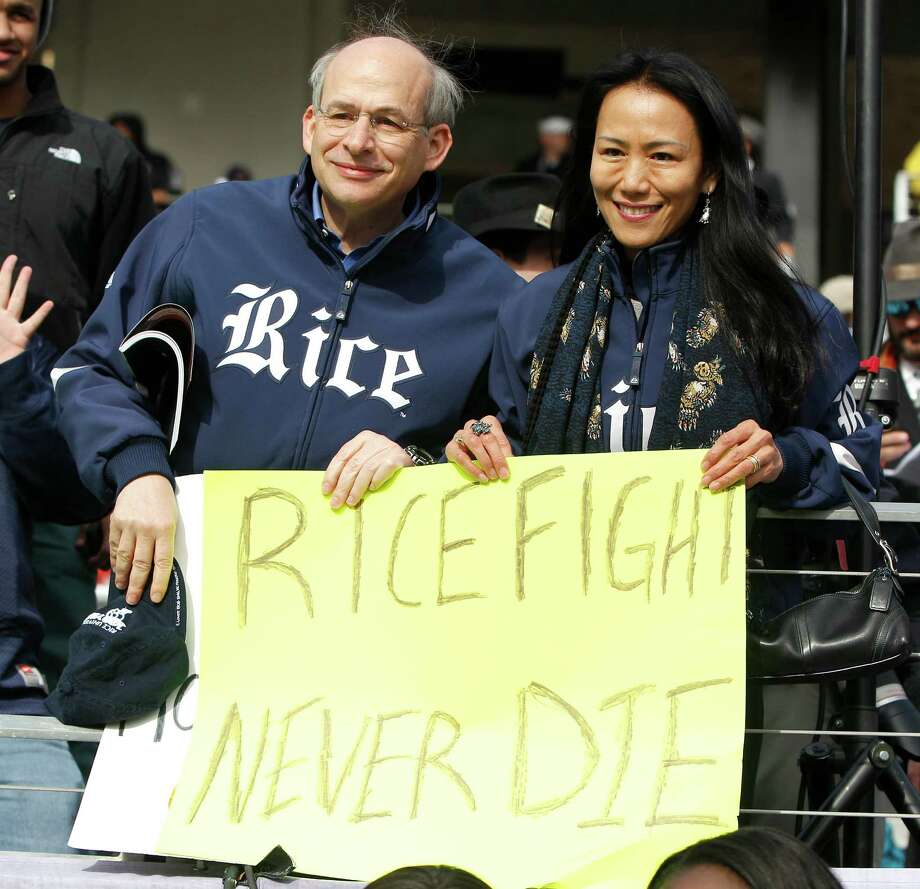 Rice University President David Leebron and his wife Y. Ping Sun celebrate in the end zone with other fans during the second  half of the Bell Helicopter Armed Services Bowl at Amon G. Carter Stadium, Saturday, Dec. 29, 2012, in Ft. Worth. Photo: Karen Warren, Houston Chronicle / © 2012 Houston Chronicle