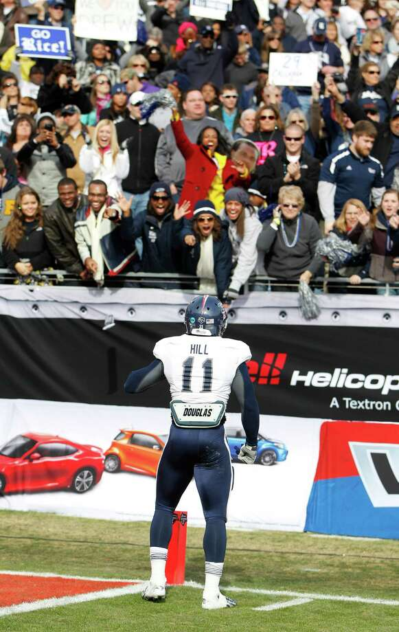 Rice safety Malcolm Hill (11) reacts with fans during the second  half of the Bell Helicopter Armed Services Bowl at Amon G. Carter Stadium, Saturday, Dec. 29, 2012, in Ft. Worth. Photo: Karen Warren, Houston Chronicle / © 2012 Houston Chronicle