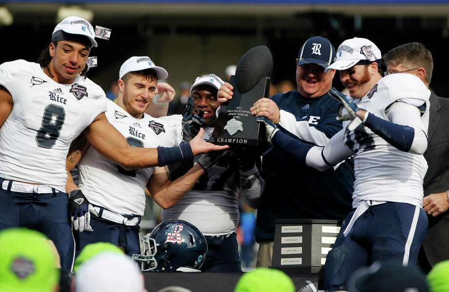 Rice head coach David Bailiff and his players celebrate with the trophy after their win during the Bell Helicopter Armed Services Bowl at Amon G. Carter Stadium, Saturday, Dec. 29, 2012, in Ft. Worth. Photo: Karen Warren, Houston Chronicle / © 2012 Houston Chronicle