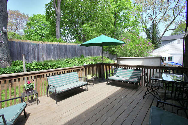 A wood deck off the back of the house offers an inviting place to enjoy the outdoors. Photo: Contributed Photo/Granite Studio