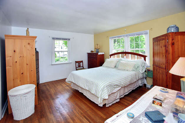 The master bedroom features hardwood floors covering a generous amount of space. Photo: Contributed Photo/Granite Studio