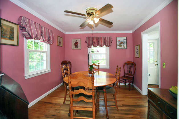 The dining room features crown molding, like the living room, and a ceiling fan. Photo: Contributed Photo/Granite Studio