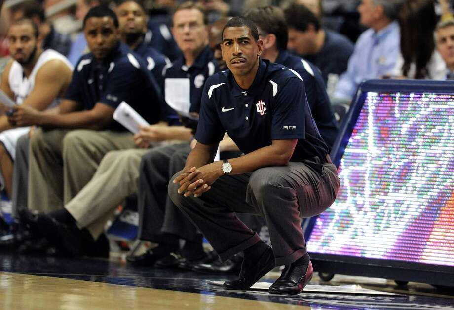 FILE - In this file photo taken Nov. 1, 2012, Connecticut head coach Kevin Ollie, right, watches play during the first half of an NCAA college basketball game in Storrs, Conn. UConn called a news conference for Saturday, Dec. 29, 2012, to announce a new contract for Ollie. A person in the athletic department said the final details were still being worked out and the contract had not been signed. The person spoke on condition of anonymity because he was not authorized to speak before the news conference. (AP Photo/Jessica Hill, file) Photo: Jessica Hill, Associated Press / FR125654 AP
