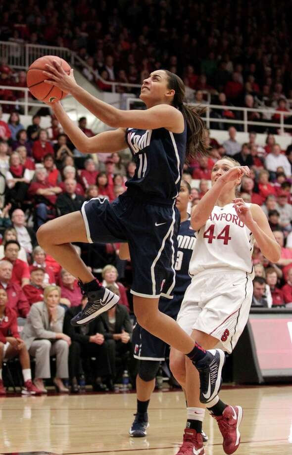 Connecticut guard Bria Hartley (14) drives to the basket past Stanford forward Joslyn Tinkle (44) during the first half of an NCAA college basketball game in Stanford, Calif., Saturday, Dec. 29, 2012. (AP Photo/Tony Avelar) Photo: Tony Avelar, Associated Press / FR155217 AP