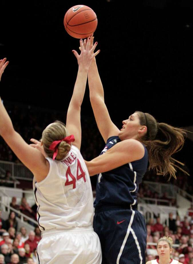 Connecticut center Stefanie Dolson, right, pulls up for a shot over Stanford forward Joslyn Tinkle (44) during the first half of an NCAA college basketball game in Stanford, Calif., Saturday, Dec. 29, 2012. (AP Photo/Tony Avelar) Photo: Tony Avelar, Associated Press / FR155217 AP