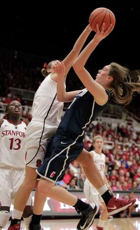 Connecticut forward Breanna Stewart, right, is fouled by Stanford forward Joslyn Tinkle (44) as she drives to the basket during the first half of an NCAA college basketball game in Stanford, Calif., Saturday, Dec. 29, 2012. (AP Photo/Tony Avelar) Photo: Tony Avelar, Associated Press / FR155217 AP