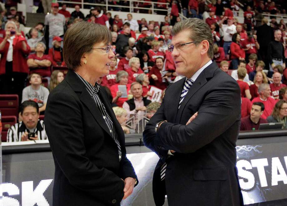CORRECST SPELLING OF COACHES NAMES - Connecticut head coach Geno Auriemma, right, talks with Stanford head coach Tara VanDerveer before the start of their NCAA college basketball game in Stanford, Calif., Saturday, Dec. 29, 2012. (AP Photo/Tony Avelar) Photo: Tony Avelar, Associated Press / FR155217 AP