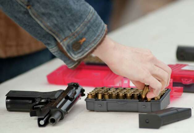 Pre-school teacher Heather Miller loads her magazine during concealed handgun license training, Saturday, Dec. 29, 2012, at Lone Star Handgun in San Antonio. Photo: Darren Abate, Express-News