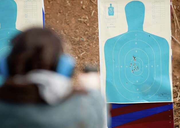 Pre-school teacher Heather Miller fires at a practice target during concealed handgun license training, Saturday, Dec. 29, 2012, at Lone Star Handgun in San Antonio. Photo: Darren Abate, Express-News