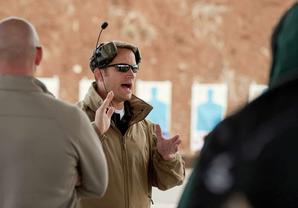 Firearms instructor Josh Felker issues instructions to his charges on the firing line during the training session.