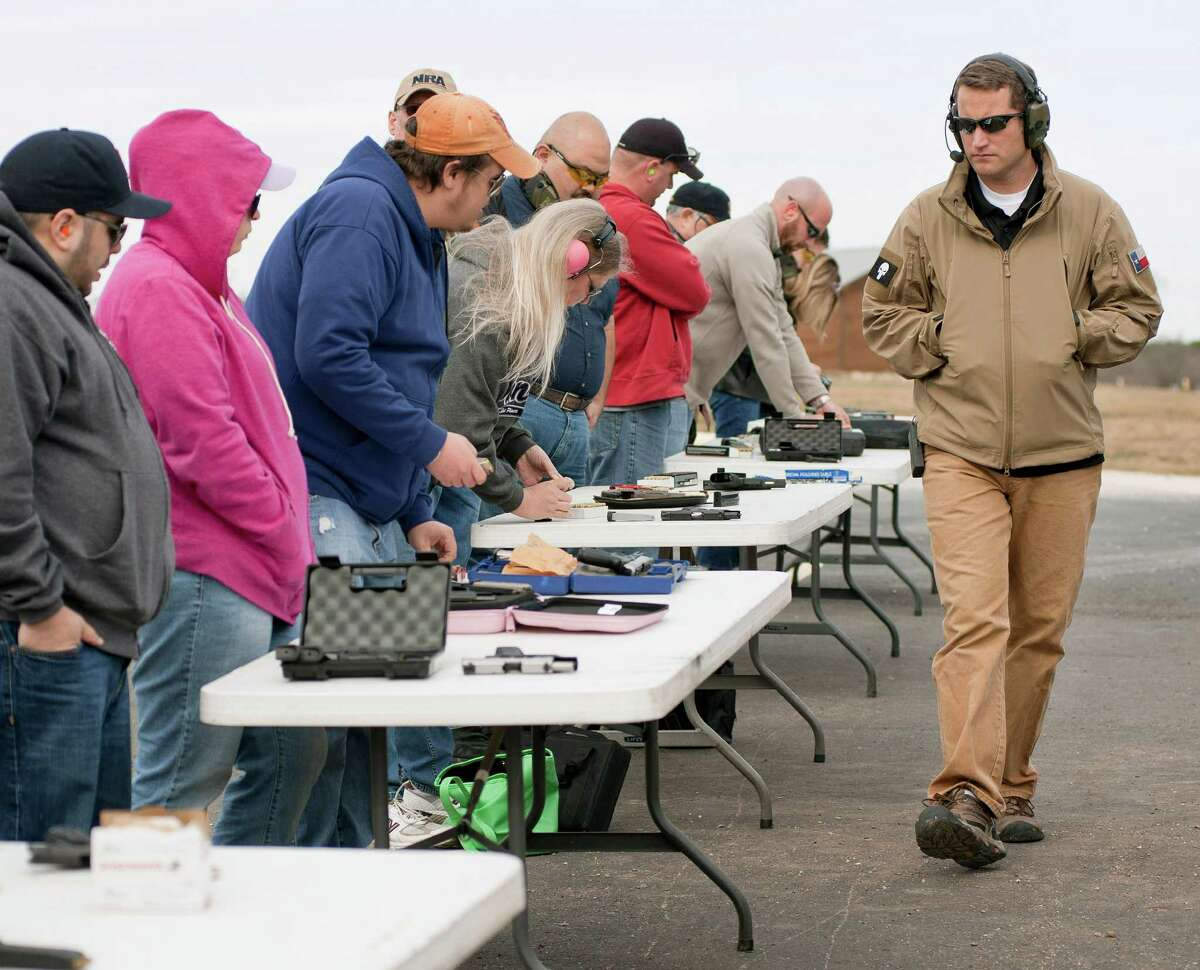 Firearms instructor Josh Felker walks the firing line during training at LoneStar Handgun. He advertised a class for teachers three days after the Sandy Hook Elementary shootings and all 400 slots were booked within 24 hours.