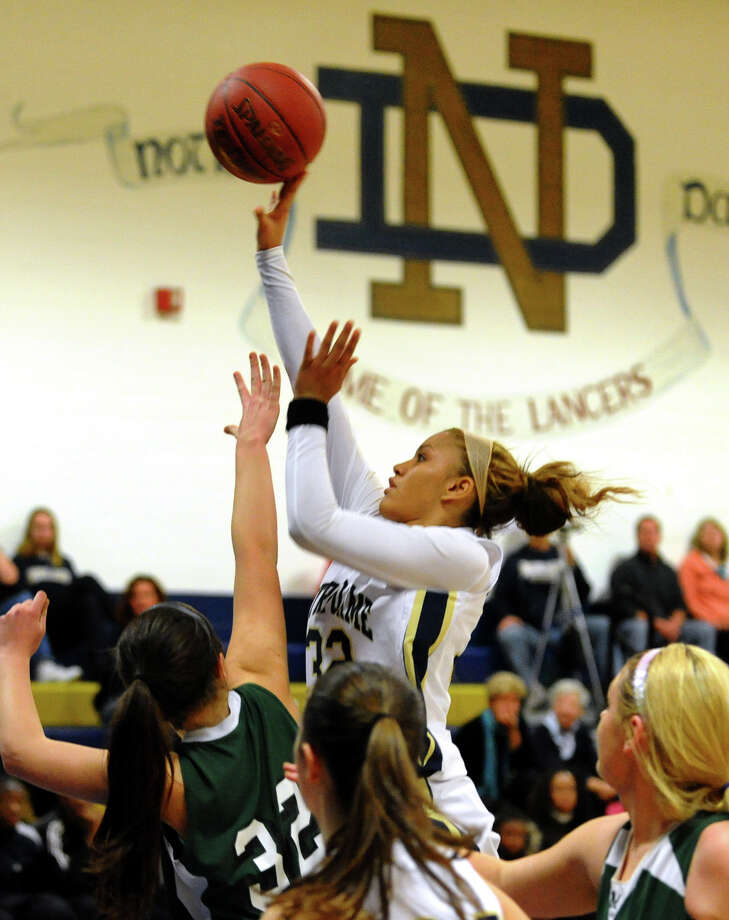 Notre Dame of Fairfield's #32 Briana Mann looks for two, during the Appalachian Classic girls basketball tournament action against Mansfield in Fairfield, Conn. on Saturday December 29, 2012. Photo: Christian Abraham / Connecticut Post