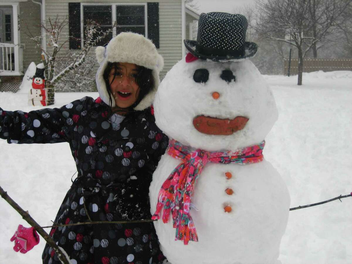 Gloria doudoukjian of Niskayuna is obviously happy at her creation after this past week?s snowstorm. It's her