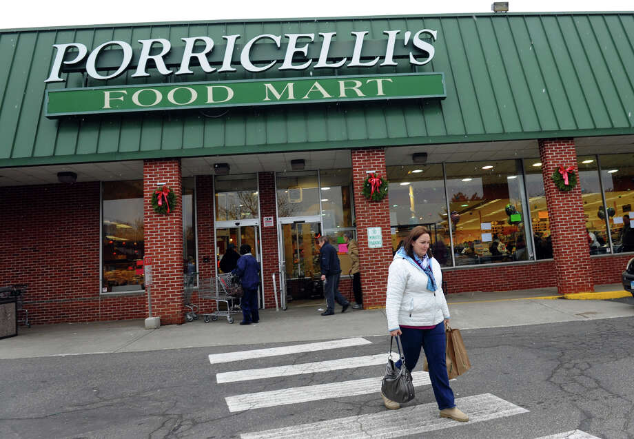 "Alison Duva, of Trumbull, exclaimed that the closing of Porricelli's Food Mart was the ""Closing of a legend."" as it remained open for the last time today in Trumbull, Conn. on Saturday December 29, 2012. Photo: Christian Abraham / Connecticut Post"