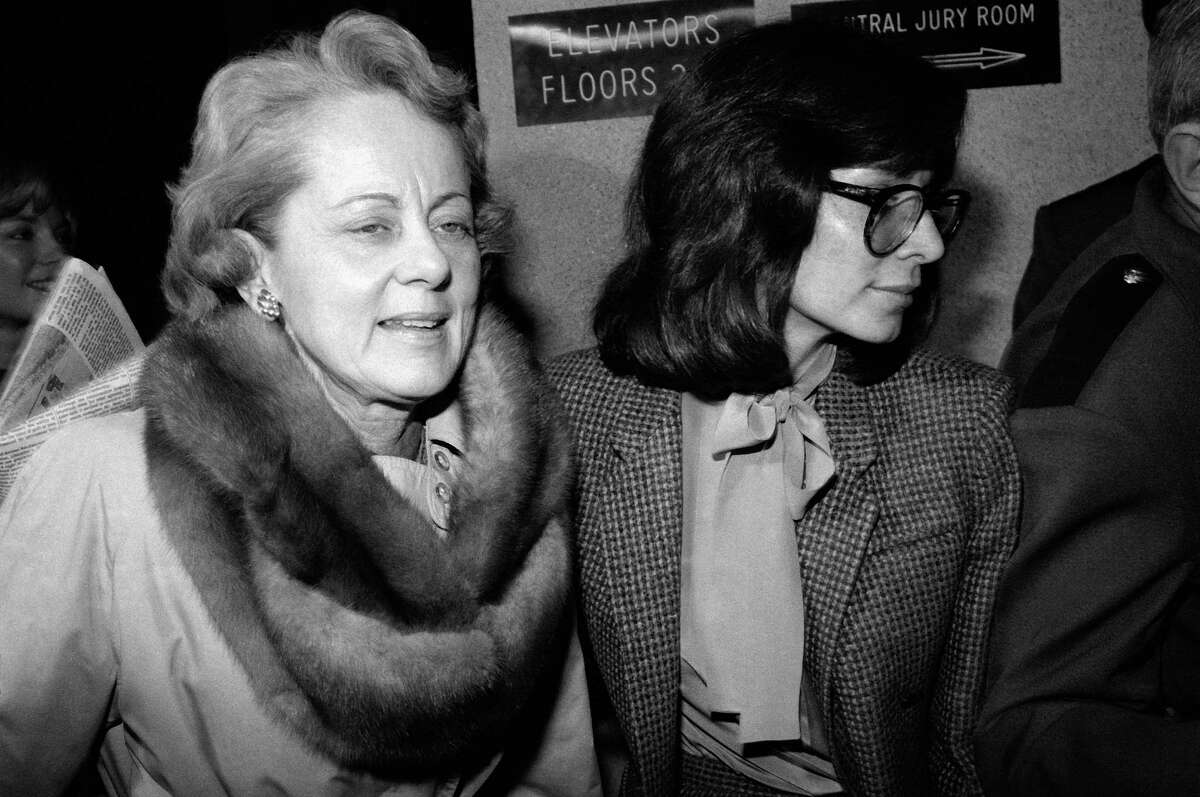 FILE - In this Feb. 9, 1981 file photo, Jean Harris, left, arrives at court in White Plains, New York Monday, Feb. 9, 1981. Harris, the patrician girls' school headmistress who spent 12 years in prison for the 1980 killing of her longtime lover,