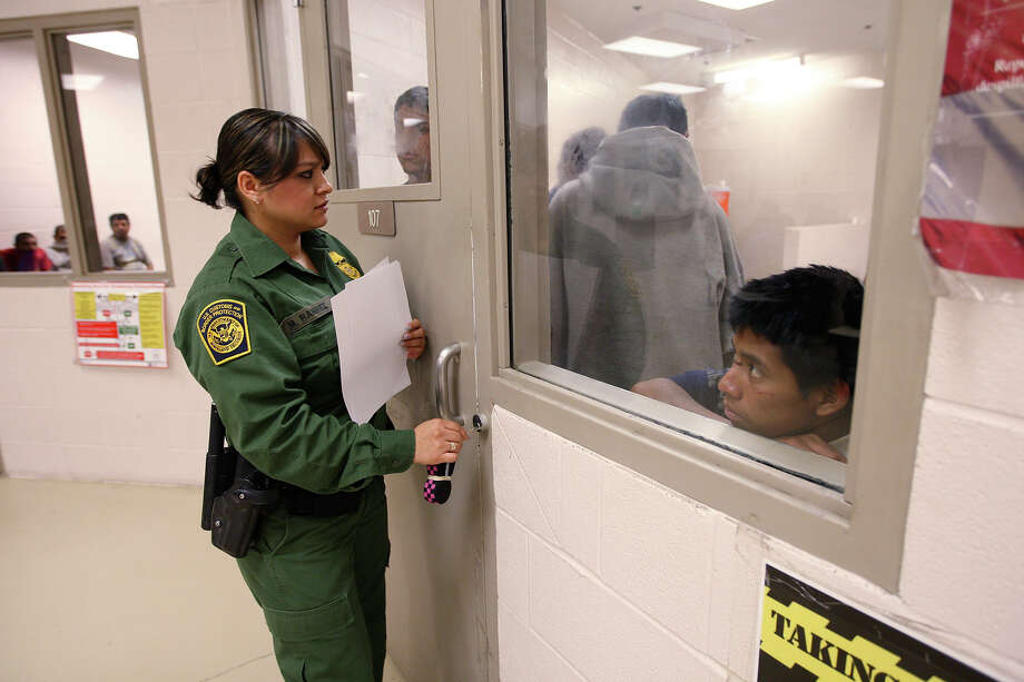 Border Patrol Agent Mari Ramirez prepares to open a holding cell for roll call at the Falfurrias station. The latest official statistics for the sector show apprehensions surged more than 60 percent from 2011 to 2012 for comparable 10-month periods. Photo: Jerry Lara, San Antonio Express-News / © 2012 San Antonio Express-News