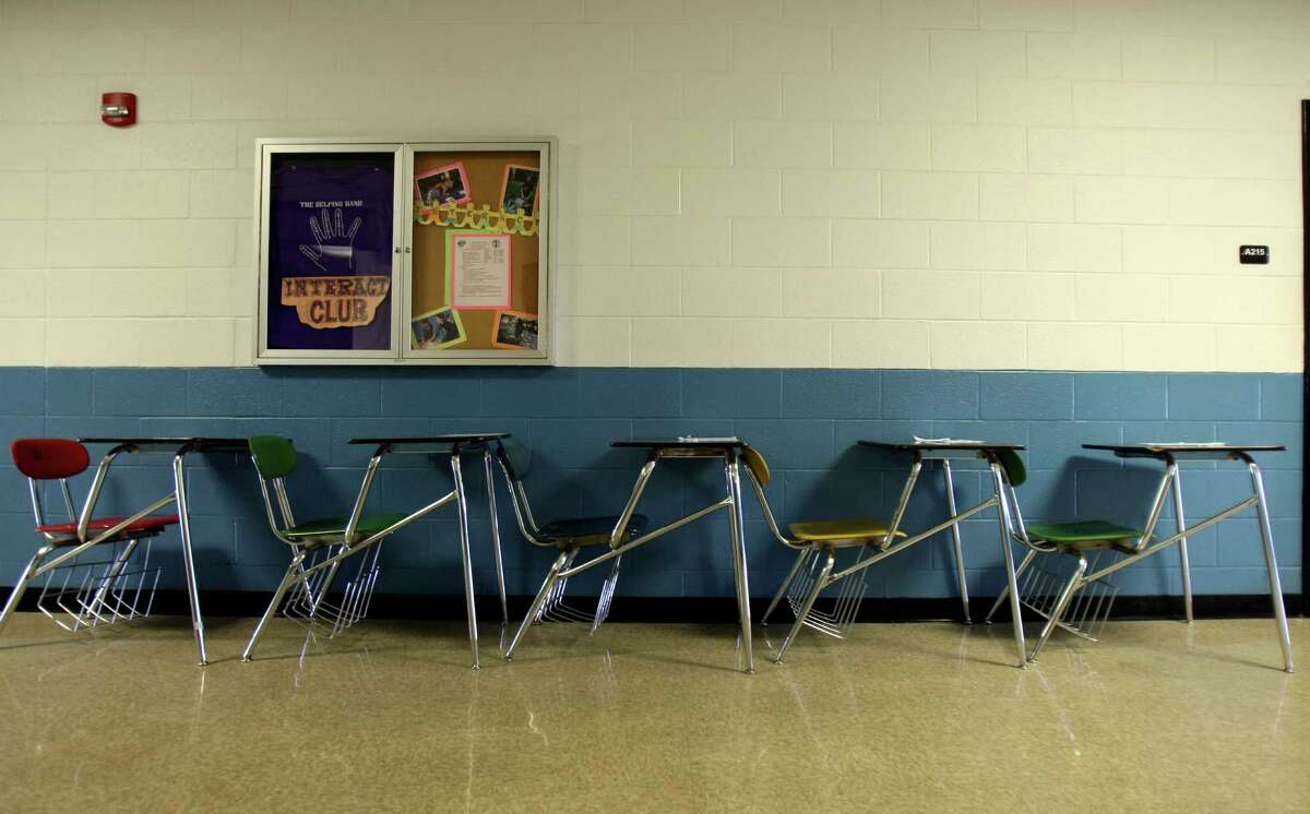 Desks line the wall of a hallway at Clark in order to accommodate larger number of students for different class periods. The students haul them in as needed.